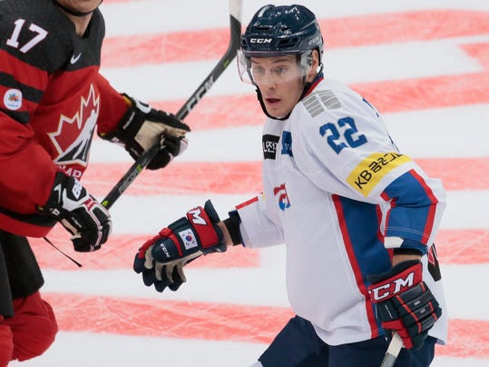 """FILE - In this Dec. 13, 2017, file photo, Korea's Michael Testwuide skates during the Channel One Cup ice hockey match between Canada and Korea in Moscow, Russia. While the Korean women's hockey team is a mix of players from South and North Korea, the men's team features seven players from North America, including American forward Testwuide. They're eligible to play for Korea because they've played there enough seasons and have a unique approach to these """"home-ice"""" Olympics.  (AP Photo/Ivan Sekretarev, File)"""