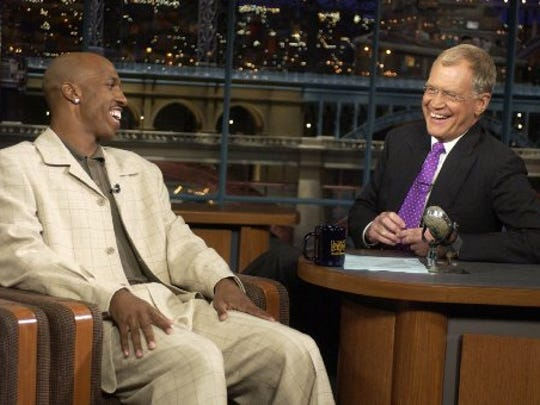 Chauncey Billips laughs it up with Letterman in 2004.