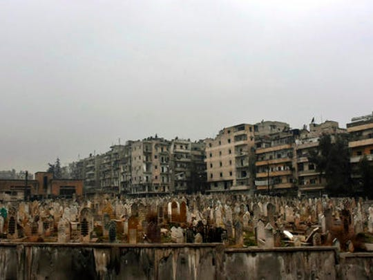 This photo released by the Syrian official news agency SANA, shows a graveyard in east Aleppo, Syria, Tuesday, Dec. 13, 2016. Syrian rebels said Tuesday that they reached a cease-fire deal with Moscow to evacuate civilians and fighters from eastern Aleppo, after the U.N. and opposition activists reported possible mass killings by government forces closing in on the rebels' last enclave.