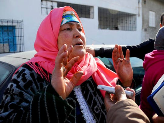 The mother of fugitive Tunisian extremist suspected in Berlin's deadly Christmas market attack, Nour El Houda Hassani, talks to media about her son, Anis Amri, in Oueslatia, central Tunisia, Thursday, Dec. 22, 2016. Amri's family members, speaking from his hometown, were shaken to learn he's the prime suspect in Monday's rampage, which killed 12.