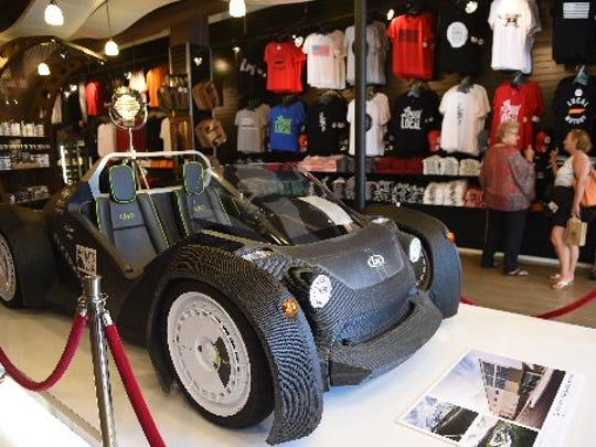Customers check out merchandise, including a 3-D printed