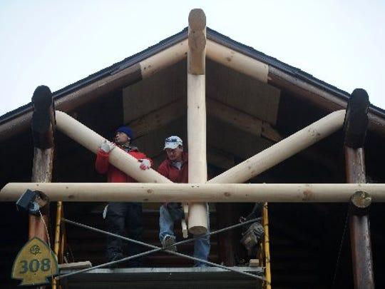 Workers rebuild a cabin at the Westgate Resort in Gatlinburg