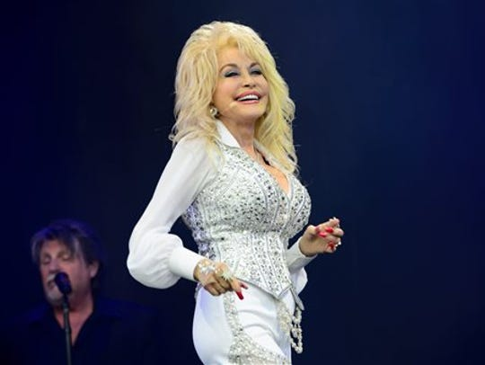 """FILE - In this June 29, 2014 file photo, U.S singer Dolly Parton performs at Glastonbury music festival, in England. Parton's cover of Roger Miller's  """"The Last In Lonesome Was Me"""" was premiered by Rolling Stone on Thursday."""