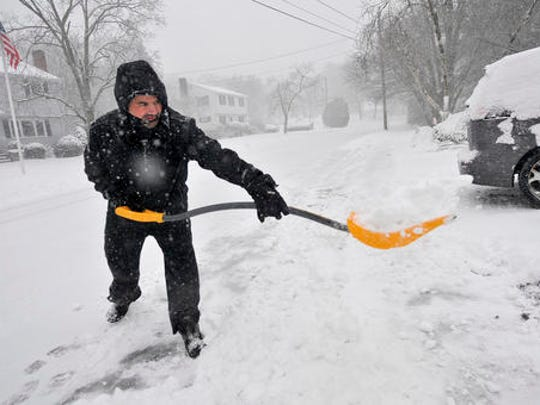 Rob Yozzo gets an early start shoveling snow from his driveway at his Birch Tree Road home in Foxborough, Mass., during a snowstorm, Thursday, Feb. 9, 2017.