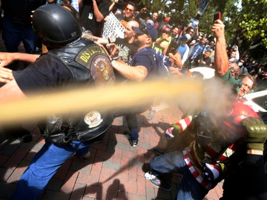 "FILE - In this April 15, 2017 file photo, pepper spray is used as anti and pro-Donald Trump protesters clash during competing demonstrations at Martin Luther King Jr. Civic Center Park in Berkeley, Calif. The campus is bracing for a showdown next week, when the conservative provocateur Ann Coulter has vowed to speak in defiance of the university's wishes. Officials, police and the campus Republicans who invited Coulter, say there are valid concerns for violence in what is being called an ongoing ""Battle of Berkeley."""