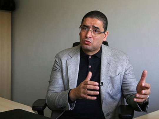 In this Wednesday, April 19, 2017 photo, Egyptian pro-government lawmaker Mohammed Abu Hamad speaks to The Associated Press during an interview in Cairo, Egypt. Abu Hamad has recently authored a draft bill that seeks to dismantle the monopoly by Al-Azhar clerics over issuing fatwas, or religious edicts, and limit the time its grand imam can stay in office.