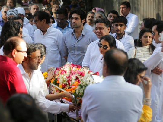 Friends and relatives carry the body of the Bollywood actor turned politician Vinod Khanna during his funeral in Mumbai, India, Thursday, April 27, 2017. Khanna died of cancer on Thursday, a hospital official said. He was 70.