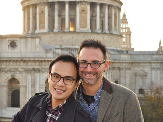 This 2015 photo provided by Kevin Ma shows Bobby Duong, left, and Christopher Koontz in front of St. Paul's Cathedral in London. The overall number of U.S. adoptions has dropped significantly in recent years, straining the viability of many adoption agencies and drawing some into conduct that authorities describe as unethical or worse. Would-be adoptive parents confront the specter of long waiting times and high fees. And many face pressure, as Duong and Kooontz did,  to spend lavishly on self-promotional advertising if they want to compete for a chance to adopt an infant.
