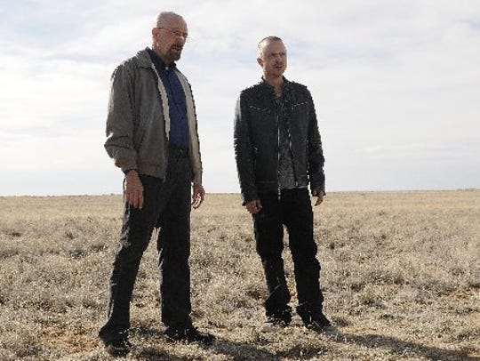 Bryan Cranston as Walter White, left, and Aaron Paul