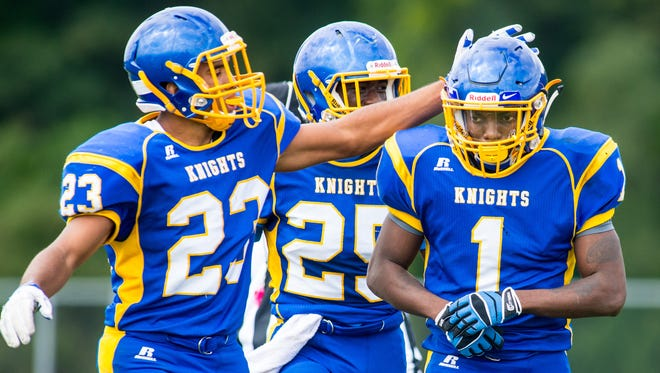 Sussex Central running back Kiante Sturgis (1) is congratulated after scoring a touchdown against Cape Henlopen on Saturday afternoon at Sussex Central.