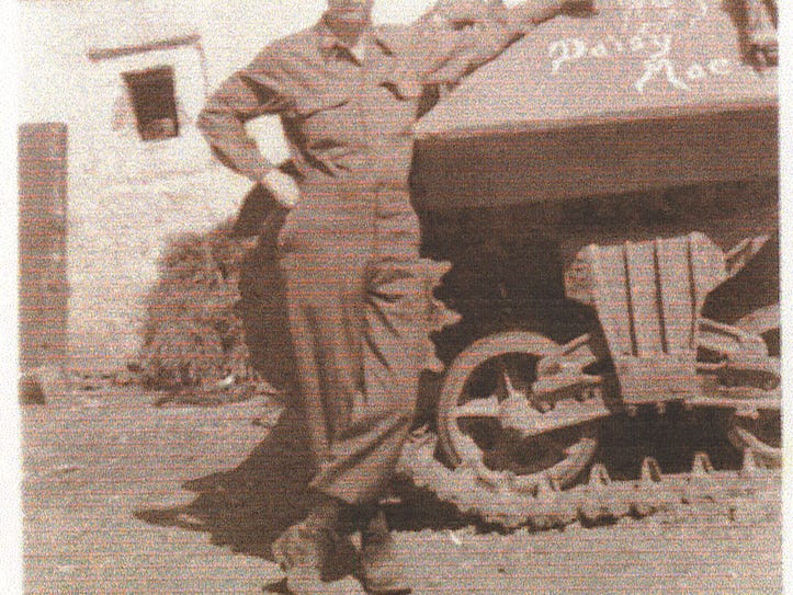 Elmer Staib standing by one of the tanks in the 610