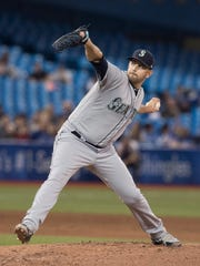 James Paxton throws to a Blue Jays batter during the ninth inning Tuesday.