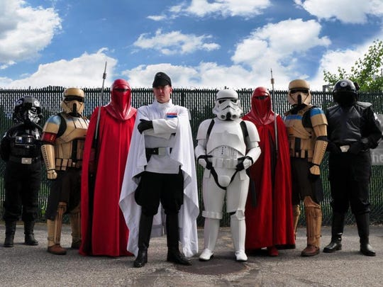 "From left, Katie Ormiston, John Hooker, Benjamin Higgins, AJ Ferrano, Ashley Frasier, Dave Williard, Anderw Liptak and Michael King appear in costume as part of the 501st Legion during ""Star Wars"" night at the Vermont Lake Monsters in summer 2017 in Burlington."