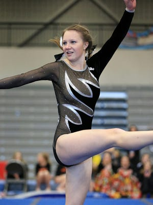 Molly McSween, a fourth-year gymnast for Plymouth, competes during Saturday's regional on floor exercise. She won on D2 parallel bars.