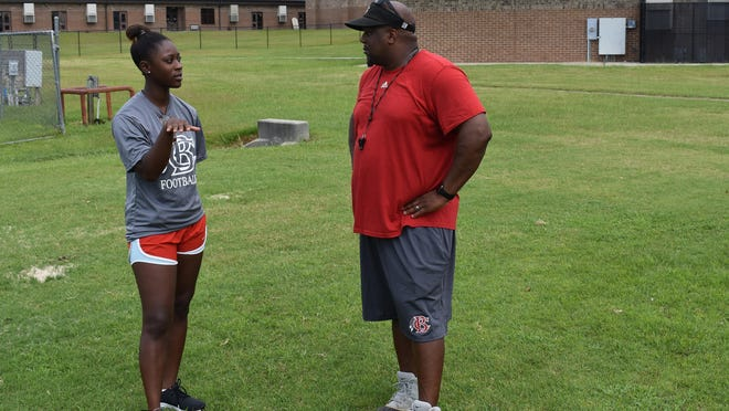Bryan County High School athletic trainer Uriyah Mathis, left, and head football coach Cherard Freeman.