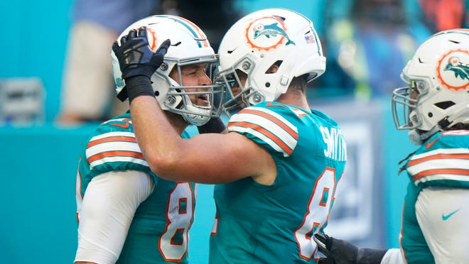 Durham Smythe (right) congratulates fellow tight end Mike Gesicki after Gesicki scored a touchdown against the Chiefs in December.