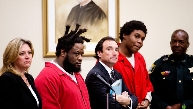 Thomas Edison, second from left, and Terrance Irons, second from right, appear before Judge Joseph Fuller at the Lee County Courthouse with their attorneys, Tracey Redd and Joe Viacava. Thw two were in court for hearing. A key witness to the murder of Andrew Faust Jr.,5, has refused to appear after being subpeonaed multiple times. The two are charged in his case with second-degree murder.