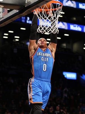 Oklahoma City Thunder point guard Russell Westbrook (0) dunks against the Brooklyn Nets during the first quarter at Barclays Center.
