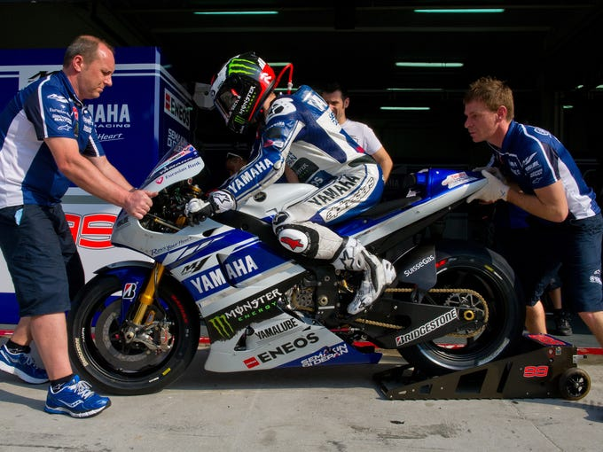 Yamaha Factory Racing's Spanish rider Jorge Lorenzo leaves his pit during the first MotoGP pre-season testing session on the last day at the Sepang circuit outside Kuala Lumpur on February 6, 2014. AFP PHOTO / MOHD RASFAN        (Photo credit should read MOHD RASFAN/AFP/Getty Images)