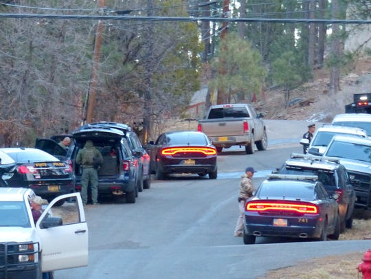 Police vehicles from Ruidoso, Alamogordo and the State