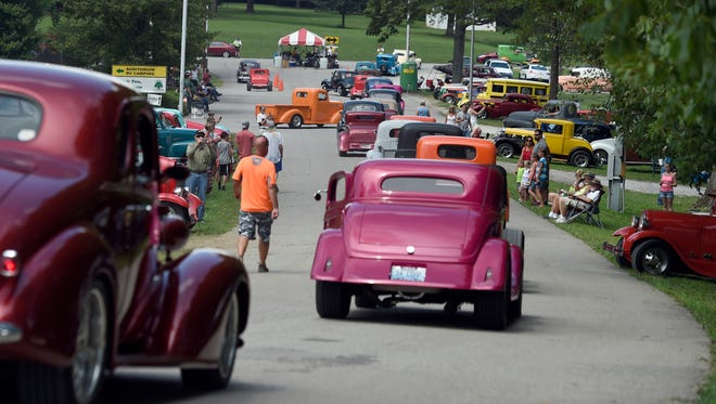 Hot rod owners head for the exit after attending the 42nd Frog Follies at the Vanderburgh County 4-H Center in Evansville last year.  The annual street rod event featuring pre-1949 vehicles drew thousands of participants and aficionados.