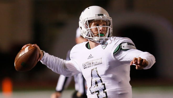 Eastern Michigan quarterback Brogan Roback passes the ball against Western Michigan during the first half of an NCAA football game Thursday, Oct. 29, 2015, in Ypsilanti, Mich.