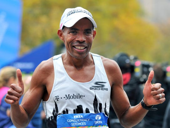 In a file photo from Nov. 1, 2015, Meb Keflezighi smiles