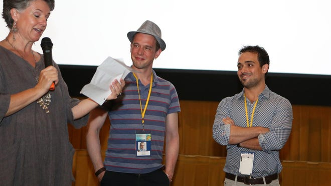 ShortFest forums producer Helen du Toit introduces filmmakers Alexis Van Stratum, center, and Adriano Valentini during last week's ShortFest at the Camelot Theatres.