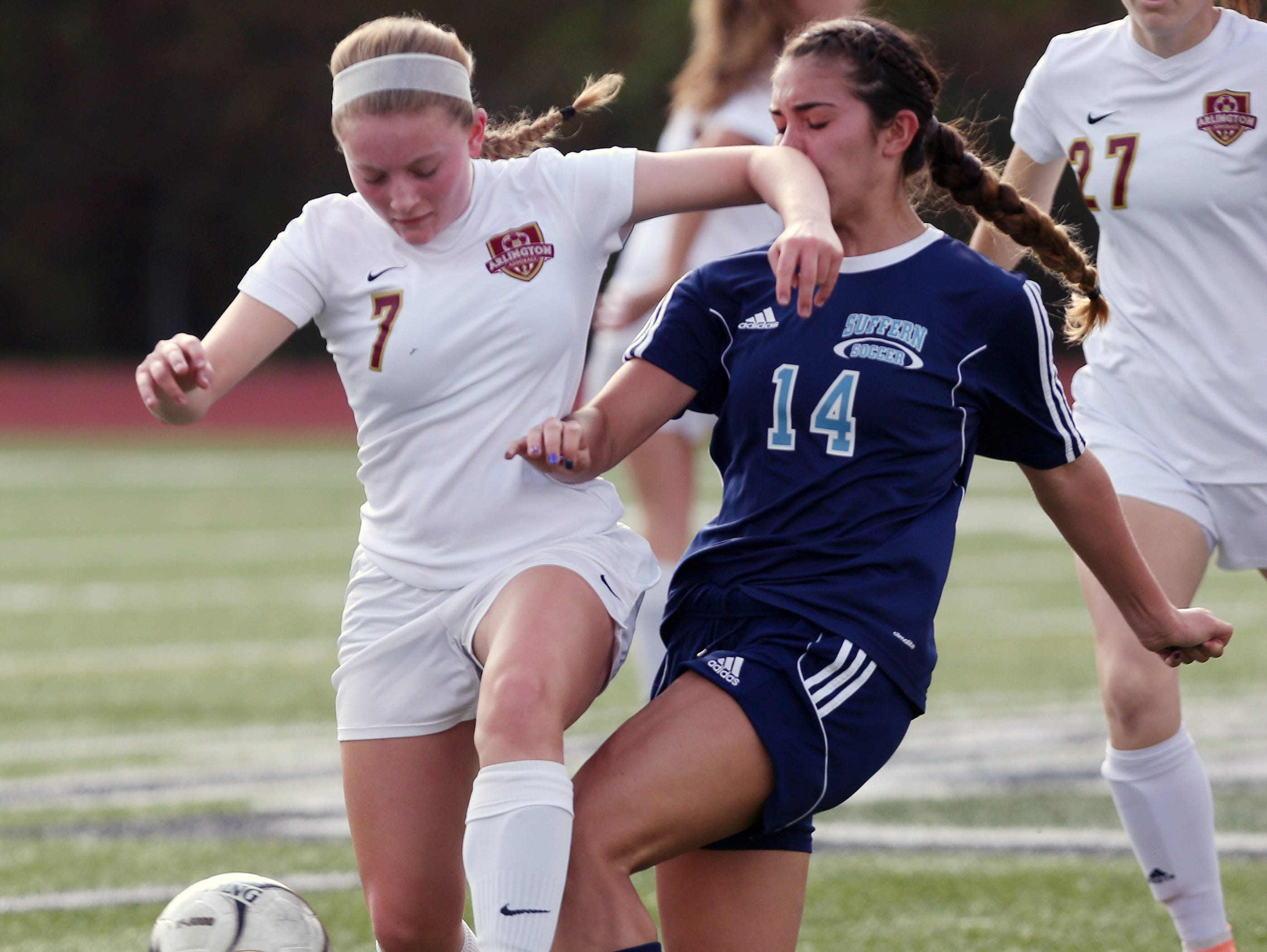 From left, Arlington's Allie Coon (7) and Suffern's Tatiana Cruz (14) battle for ball control during the girls soccer Section 1 Class AA championship game at Yorktown High School Oct. 30, 2016. Arlington won the game 2-0.