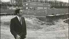 In this 1956 photograph, Edward Elias survey the construction of the first building on the Penn State York campus.