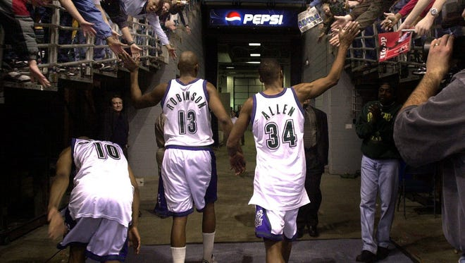 """The """"Big Three"""" for the Milwaukee Bucks – Sam Cassell, Glen Robinson and Ray Allen –  celebrate with fans after a victory during the 2001 season."""
