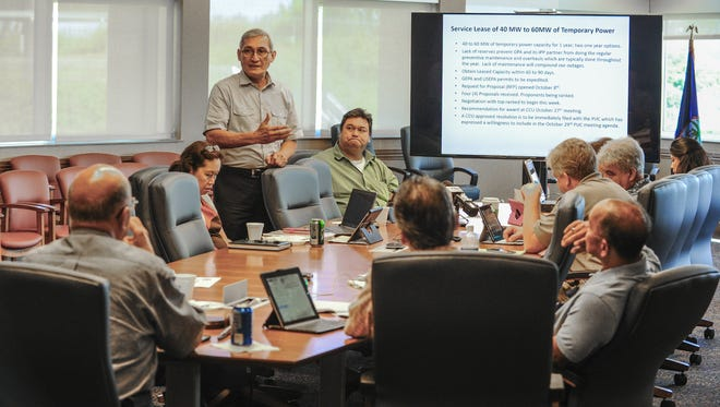 Guam Power Authority General Manager John Benavente, standing, addresses members of the Consolidated Commission on Utilities on the option of a service lease form temporary power during a commission meeting at the Gloria B. Nelson Public Service Building in Mangilao on Wednesday, Oct. 14, 2015.