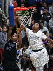 Cordova's Tyler Harris (right) blocks a layup by Bolton's Bryce Good's on a fast break during the Wolves' 70-63 overtime win Tuesday in the District 14-AAA championship game at Bartlett.