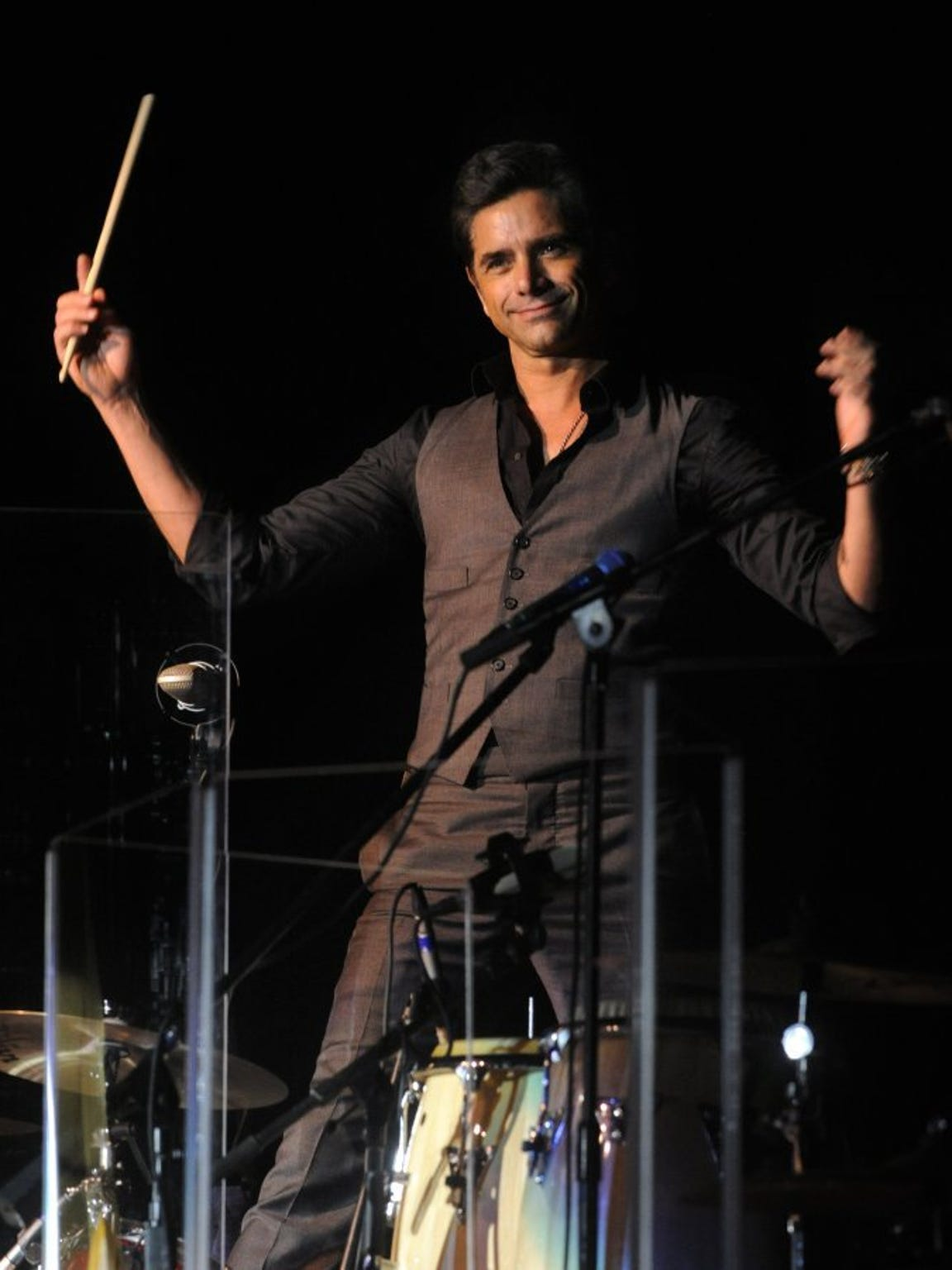 Actor John Stamos stands above a drum set Sunday night during the Beach Boys concert March 6, 2016, at the Taylor County Coliseum. Stamos played drums and guitar with the band that night.