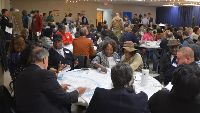 Members of the West Trinity Lane area community participate in the first night of the charrette held at Born Again Chuch.
