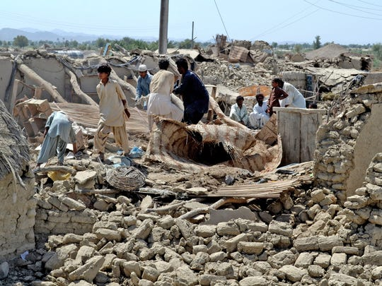Sep 24, 2013: 825 killed in Pakistan. Pakistani villagers look for belongings amid the rubble of their destroyed homes following an earthquake in the remote district of Awaran, Pakistan, on Sept. 25, 2013.