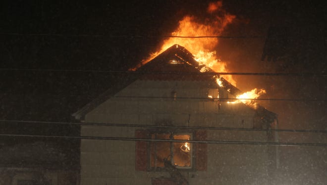 A quick-moving fire destroyed home at 2226 Edgemere Drive in Greece Monday.