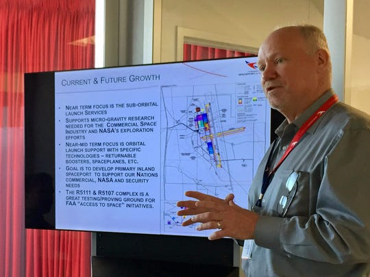 Spaceport America CEO Dan Hicks discusses the spaceport's plans for future growth and infrastructure needs during a forum with economists and journalists at the spaceport in April 2017.