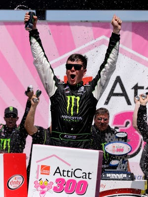 Erik Jones celebrates with his crew in Victory Lane after winning the NASCAR Xfinity series auto race at Chicagoland Speedway on Sunday.