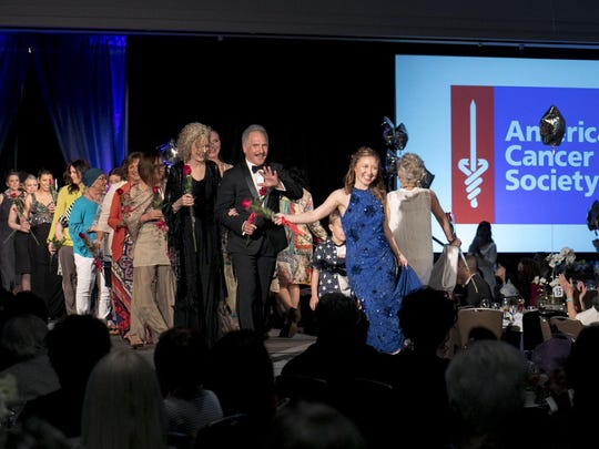 Cancer survivors model the latest fashions at the American Cancer Society Fashion Show