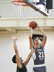 Jack Nunge (22) of the Pocket City team goes up for a layup, against Ryan Batte of Cincy Lakers, during the Adidas Invitational at Warren Central on July 6, 2016.