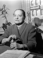 In this Feb. 20, 1958 file photo, businesswoman Helena Rubinstein poses in her office in New York. Rubinstein built a cosmetics empire on the notion that beauty is power. A new exhibition at the Jewish Museum in New York highlights her rise, interests and acquisitions in 200 objects.