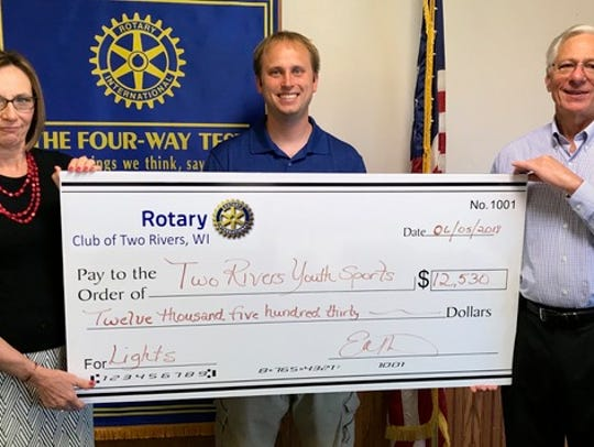 Two Rivers Rotary Club President Dr. Bob Gahl and member