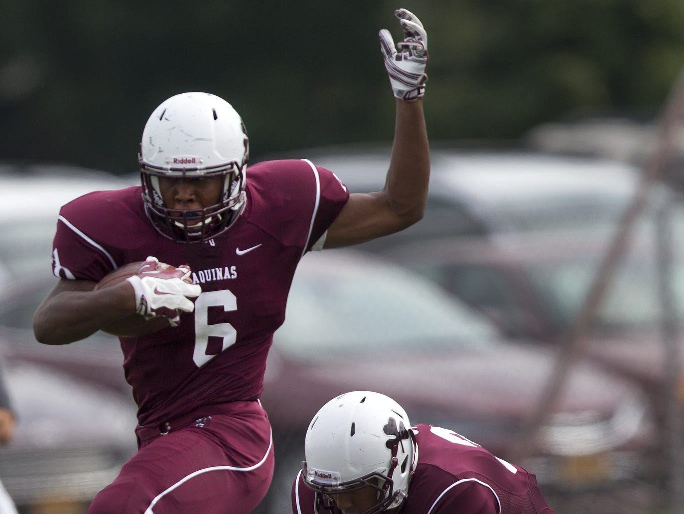 Aquinas rising senior Taylor Riggins accepted an offer of a football scholarship from Syracuse University.