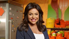"""Rachael Ray started out with several series on the Food Network, including """"30 Minutes Meals,"""" which launched several cookbooks based on the premise. She currently hosts the daytime talk show """"Rachael Ray,"""" which features cooking and celebrity guests."""