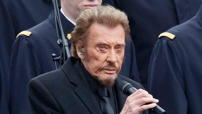 In this Jan. 10 2016 file photo, French rock star Johnny Hallyday sings during a ceremony to honor the victims of the Islamic extremist attacks at Place de la Republique in Paris.
