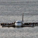 This file photo from Jan. 15, 2009, shows passengers being rescued from  US Airways Flight 1549 that went down in the Hudson River near New York City.