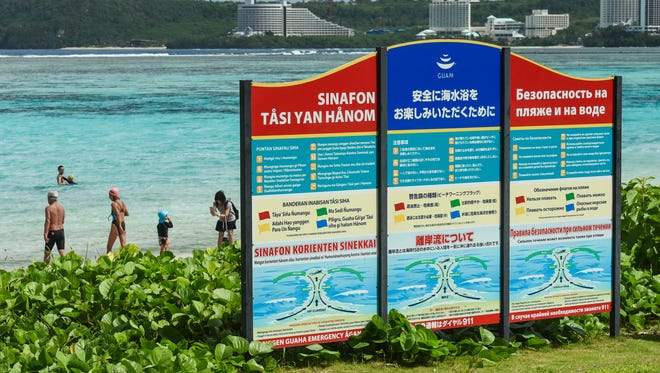 A warning sign, offering safety tips and notices to beachgoers, could be seen along the shoreline of Ypao Beach in Tumon on Friday, Oct. 28. The sign displays the warnings in various languages.