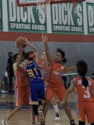 Bina Clifford, fourth from left, reaches to block a shot in this undated photo. The Melissa preteen landed a spot on the 11U state Team Texas US Basketball team, which competes against teams from multiple states today through Aug. 9 at the US Basketball tournament in Atlanta. Composed of teams of boys and girls ages 10-17 from throughout the state, Team Texas is led by Director Keisha Anderson. Clifford, 11, is an incoming sixth grade student at Melissa Middle School.
