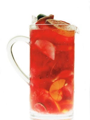 Sangria, made with a variety of fresh fruit and wine, is a delicious summer drink.